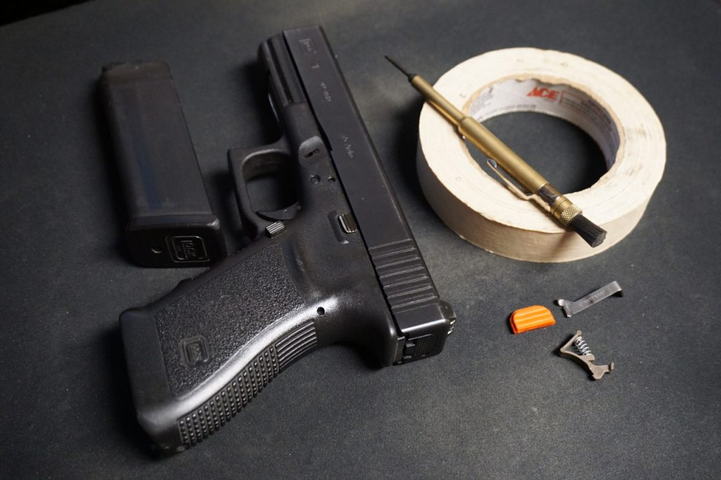 A small punch and a roll of tape, all you need for a Glock!
